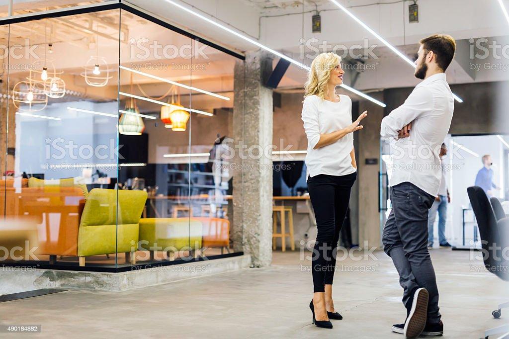 Office talk between coworkers stock photo