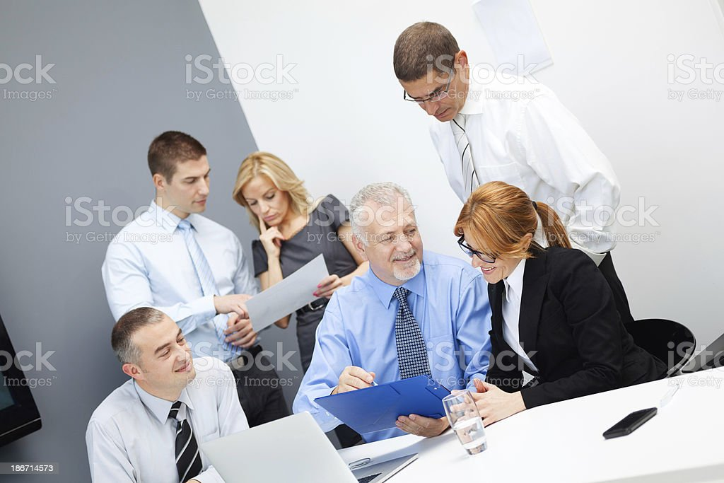 Office team discussing business proposal. royalty-free stock photo