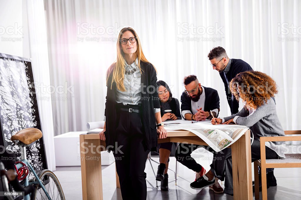 Office team working on tasks - New and young business stock photo