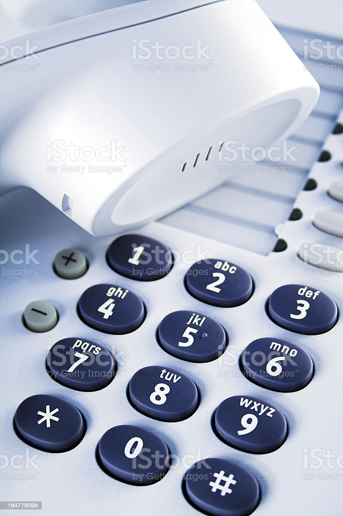 Office telephone. Detail of earpiece and keypad. royalty-free stock photo