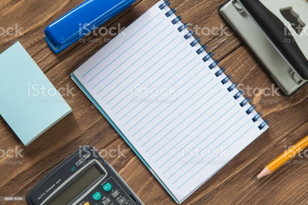 Office tools organized on wooden background stock photo