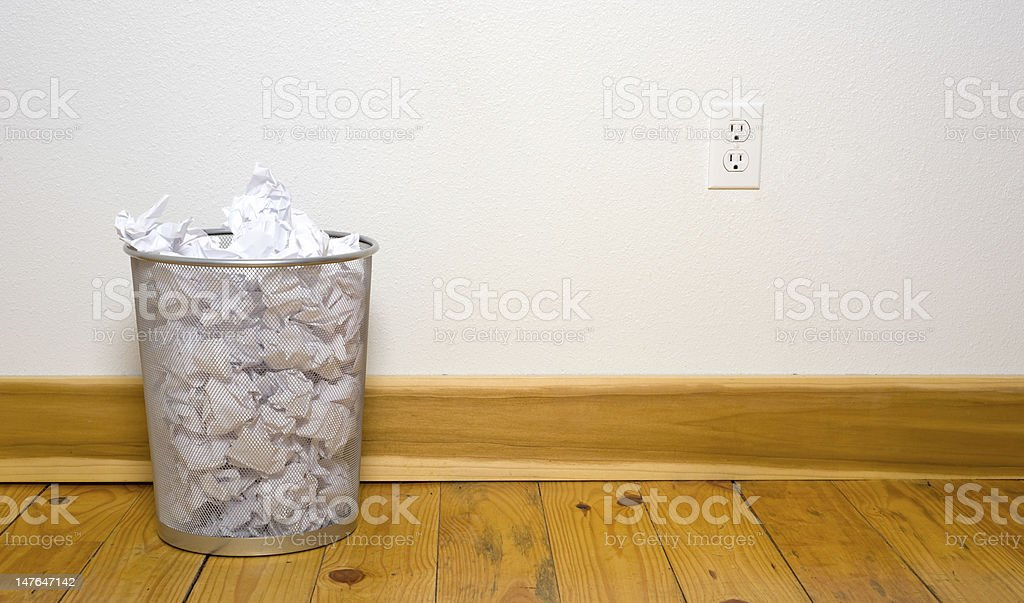 Office trash can on wood floor stock photo