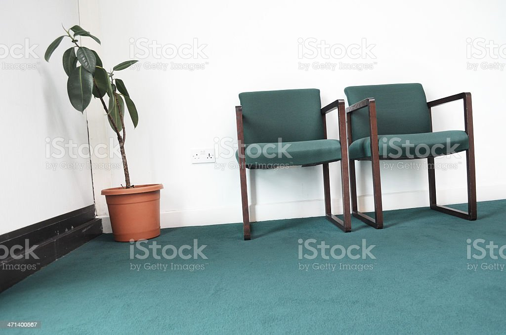 office waiting room with plant, two chairs and carpet royalty-free stock photo