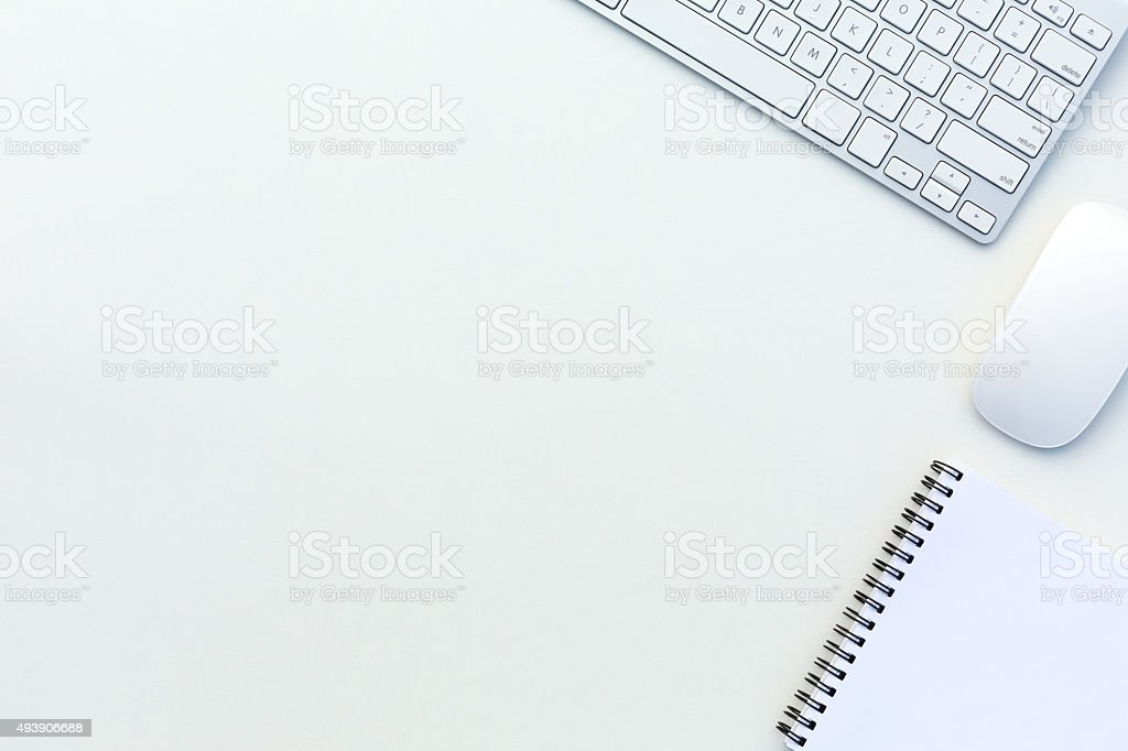 Office White Table with Computer Keyboard Mouse and Notepad stock photo