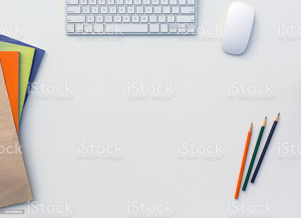 Office White Table with Computer Keyboard Mouse Color Pencils Booklets stock photo