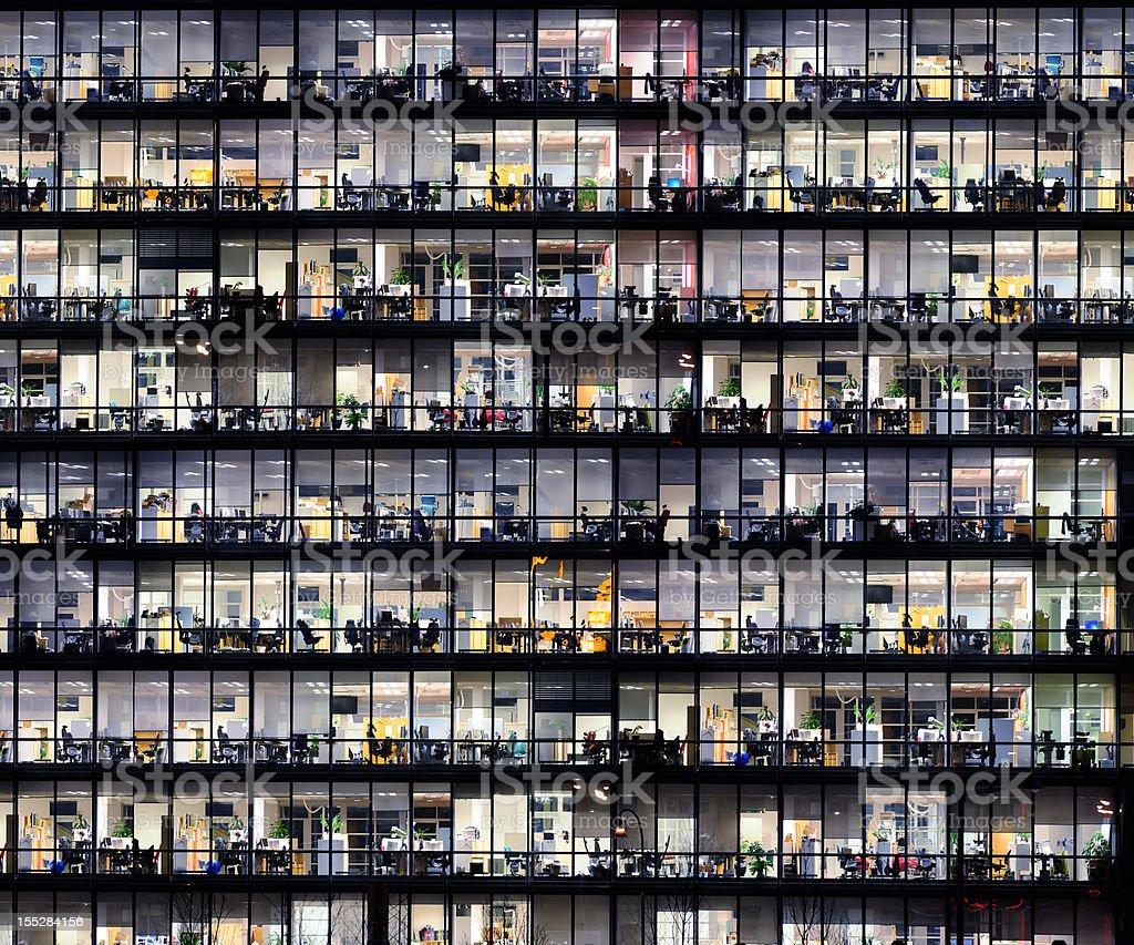 Office windows by night. stock photo