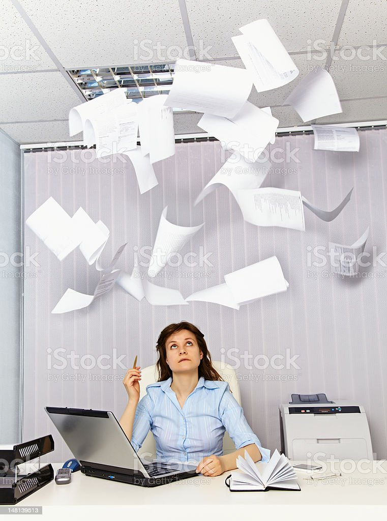 Office worker and annoying documentation royalty-free stock photo