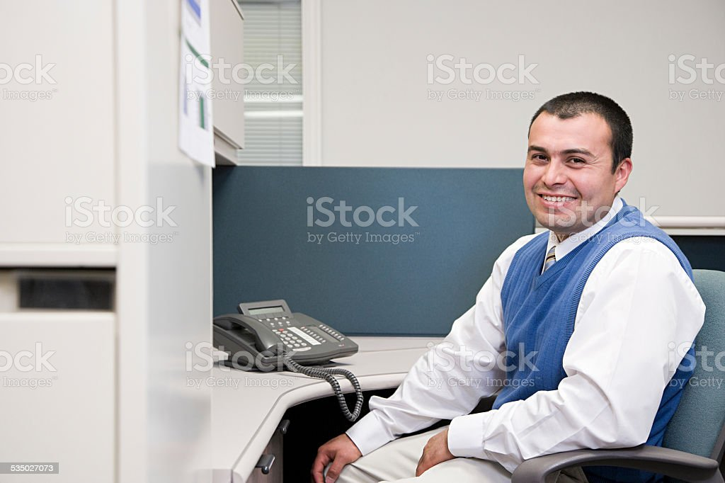 Office worker at his desk stock photo