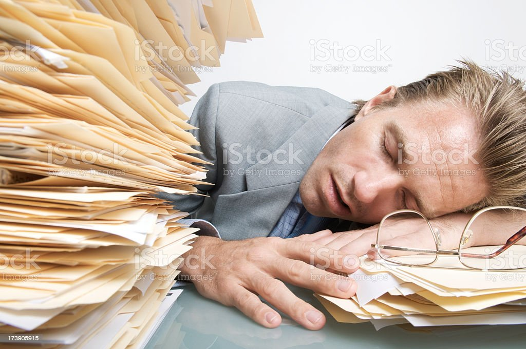 Office Worker Businessman Asleep Napping at Desk in Paperwork royalty-free stock photo