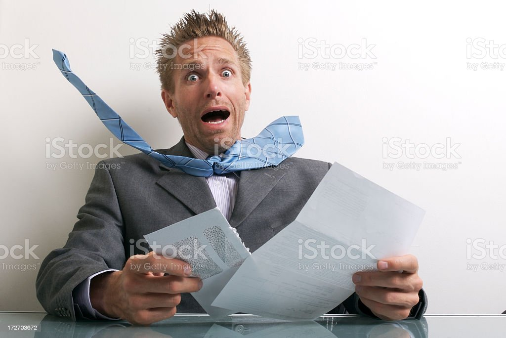 Office Worker Businessman Opening Letter with Expression of Stress royalty-free stock photo