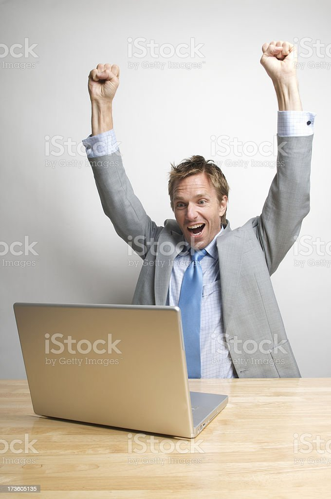Office Worker Celebrates in front of Laptop royalty-free stock photo
