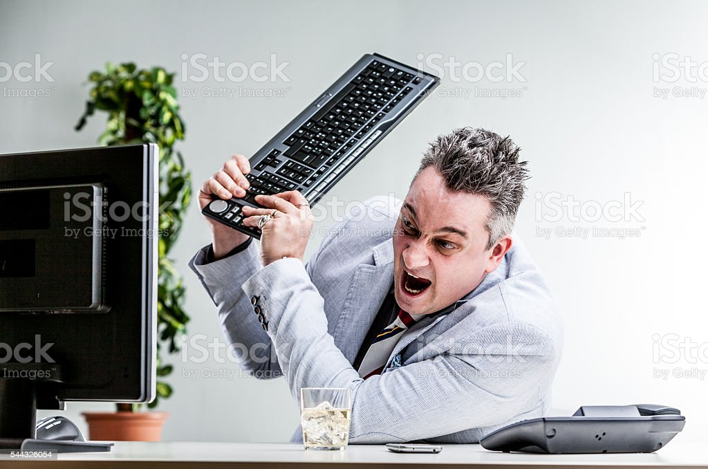 office worker destroying his computer stock photo