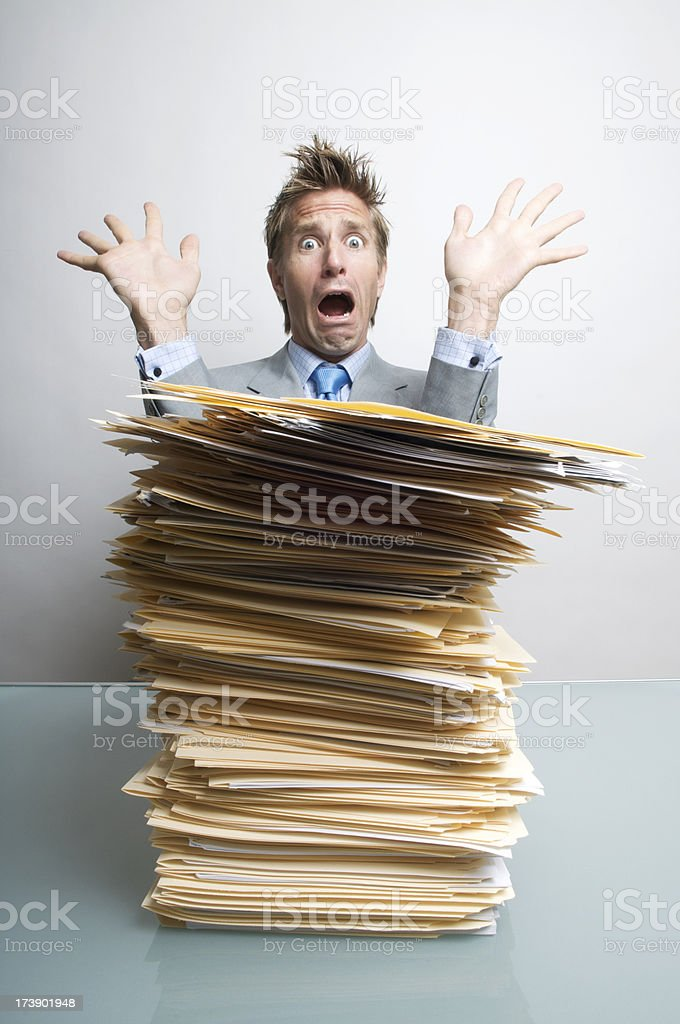 Office Worker Freaks Out Behind Inbox royalty-free stock photo