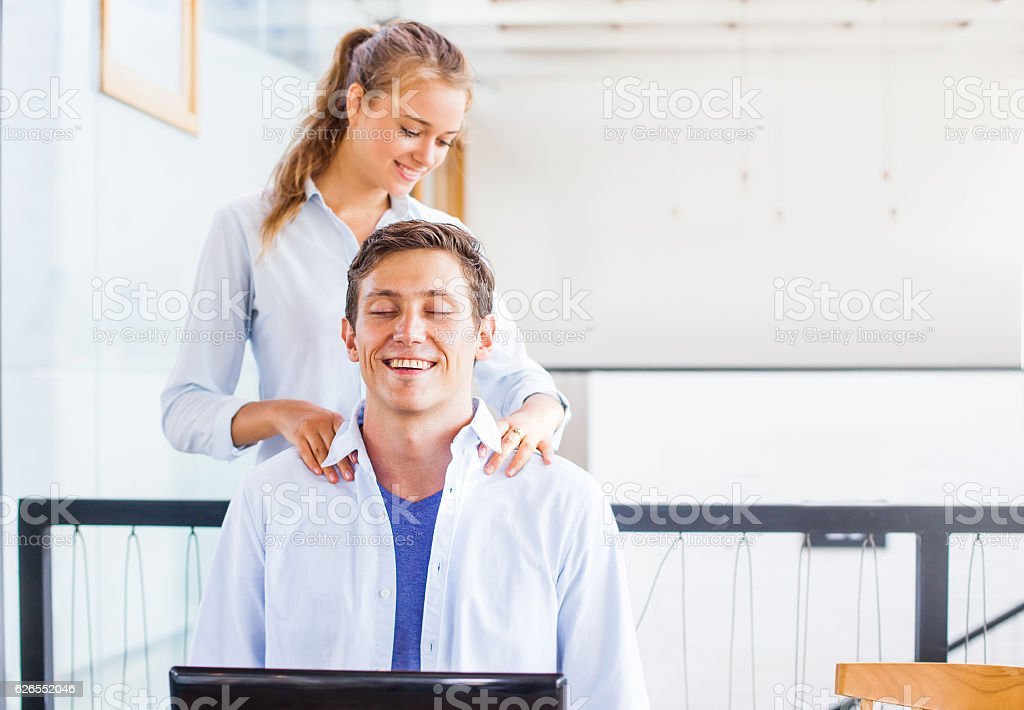 office worker getting massage on his workplace. stock photo