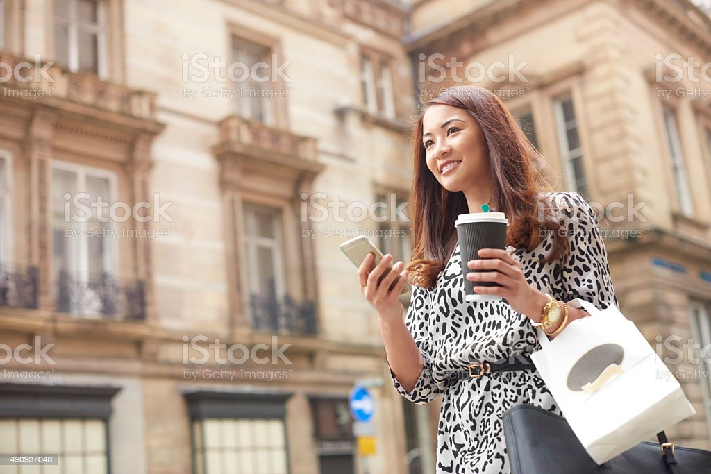 office worker hailing an online taxi stock photo