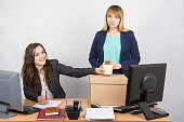 Office worker happily helps collect things sacked colleague