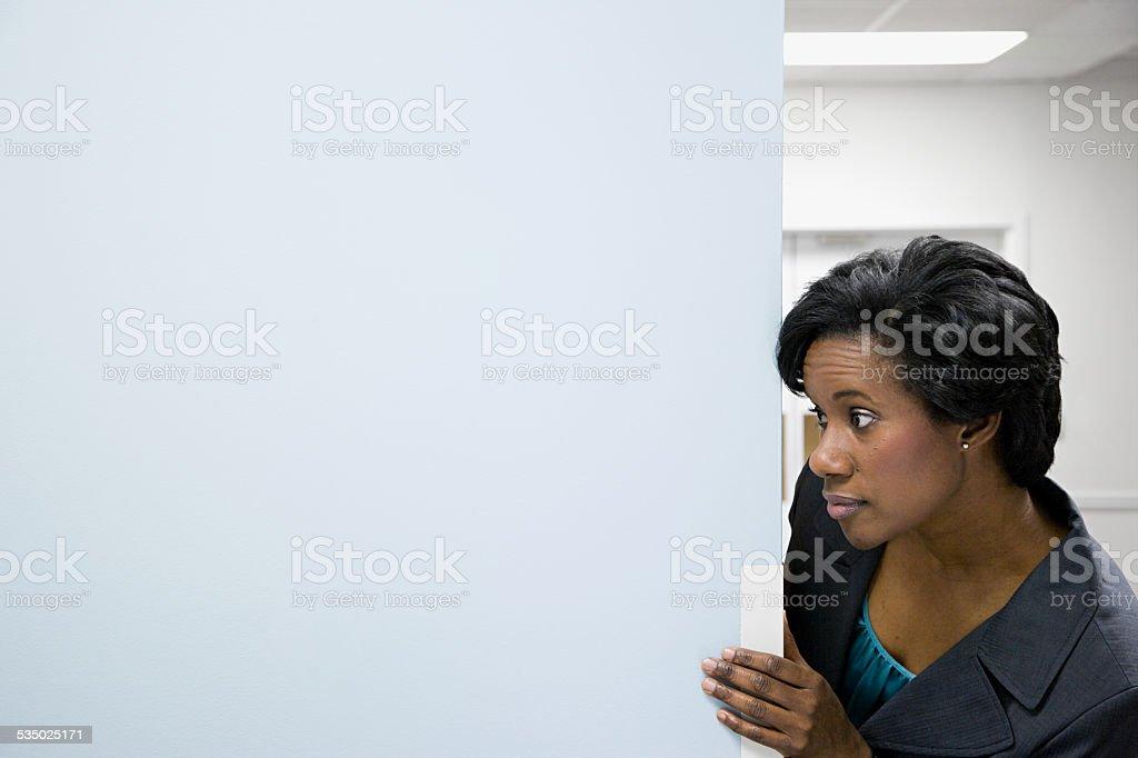 Office worker in corridor stock photo