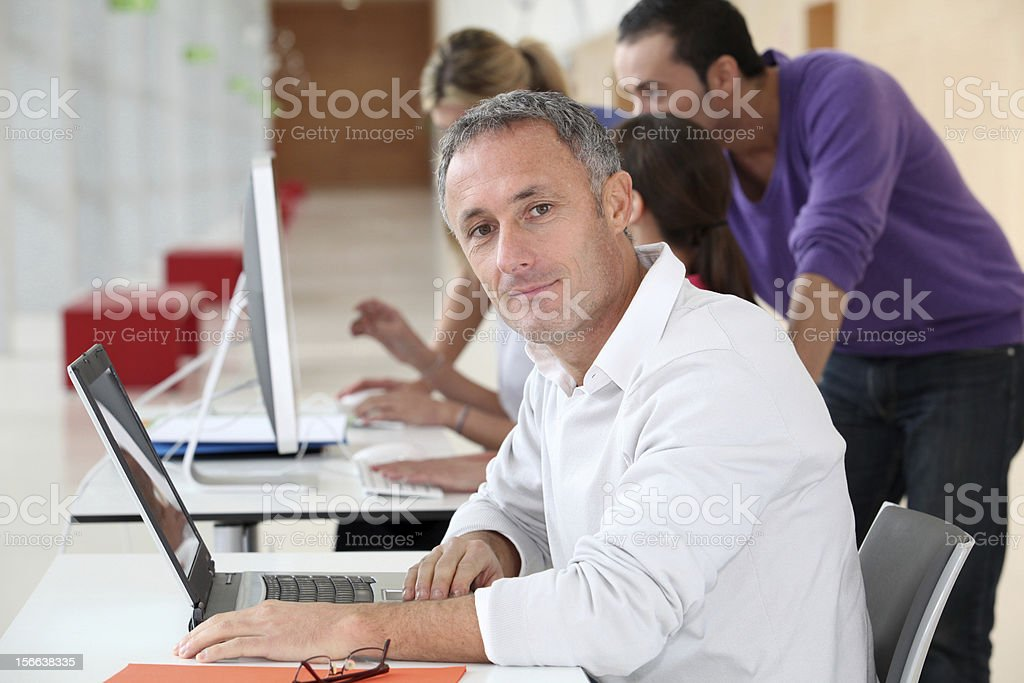 Office worker in front of laptop computer royalty-free stock photo