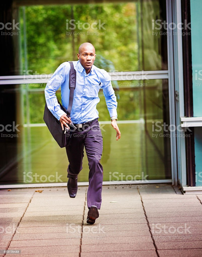 Office worker late for his bus stock photo