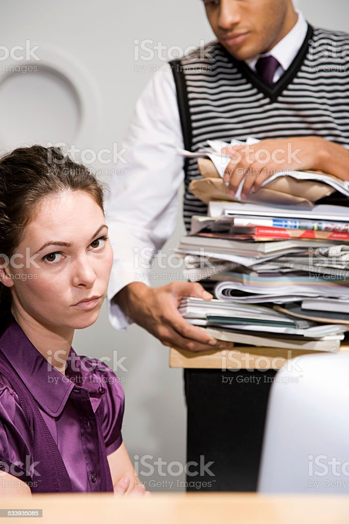 Office worker looking annoyed stock photo