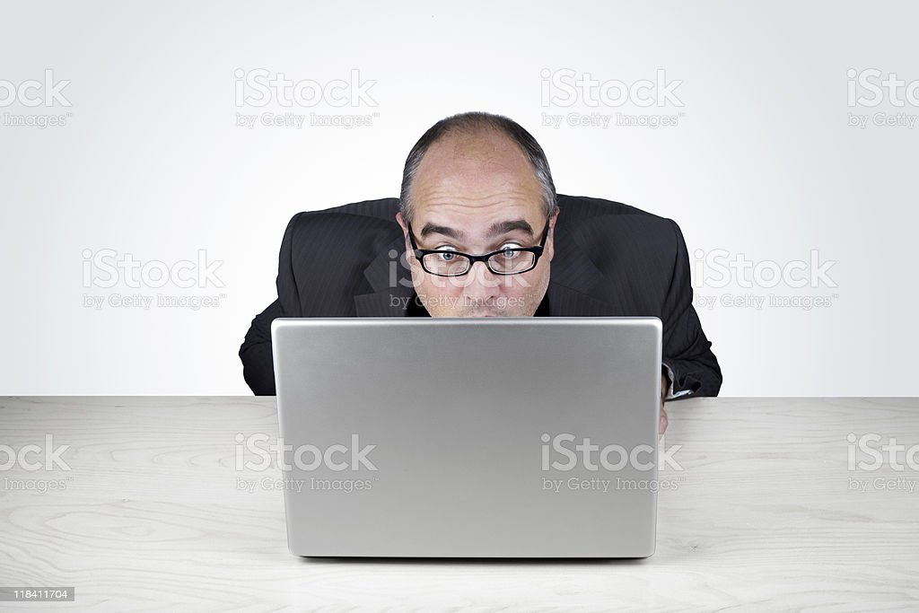 WTF? -Office worker looks very surprised at his laptop royalty-free stock photo