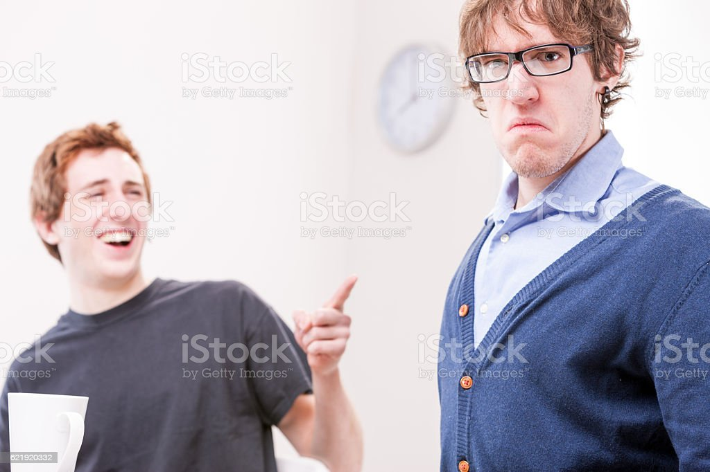 office worker makin fun of his colleague stock photo