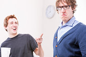 office worker makin fun of his colleague