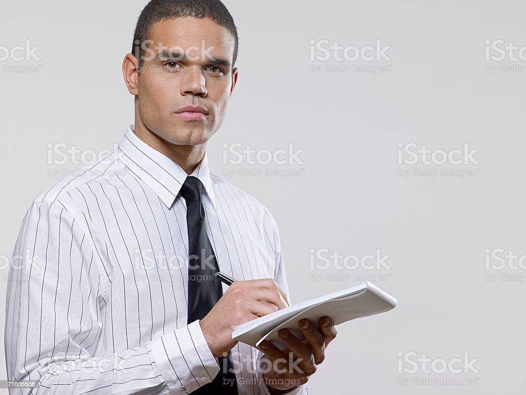 Office worker making notes stock photo