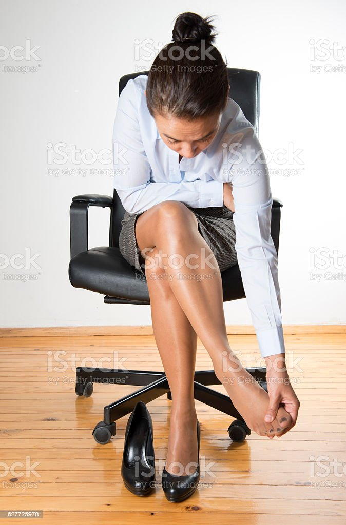 Office Worker Massaging Foot stock photo