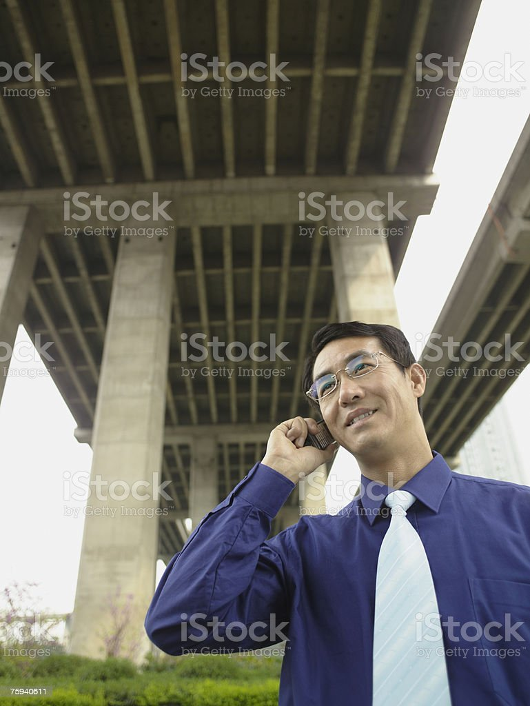 Office worker on cellphone stock photo