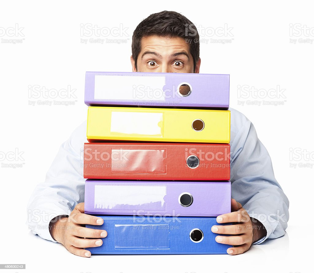 Office Worker Peering With Wide Eyes Over Files - Isolated royalty-free stock photo