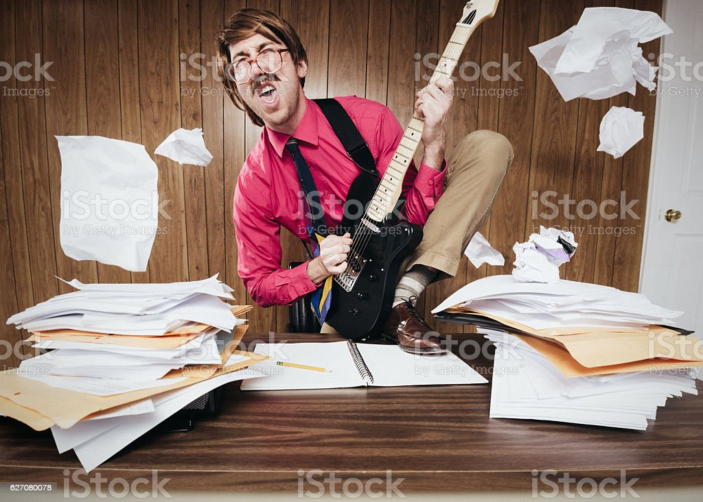 Office Worker Playing Electric Guitar stock photo