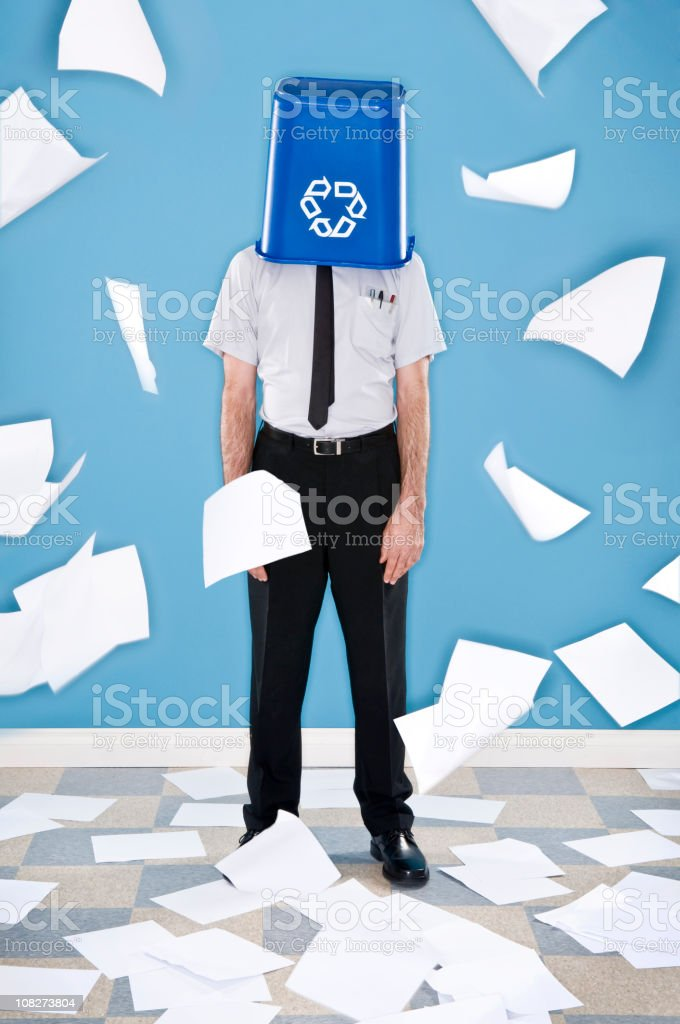 Office worker recycling sheets of paper. royalty-free stock photo