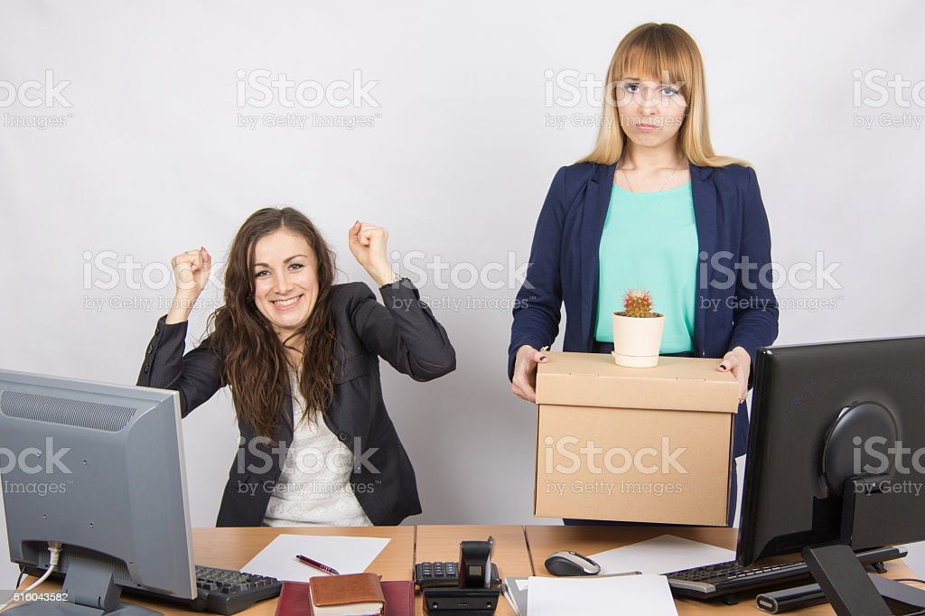 Office worker rejoices that fired colleague stock photo