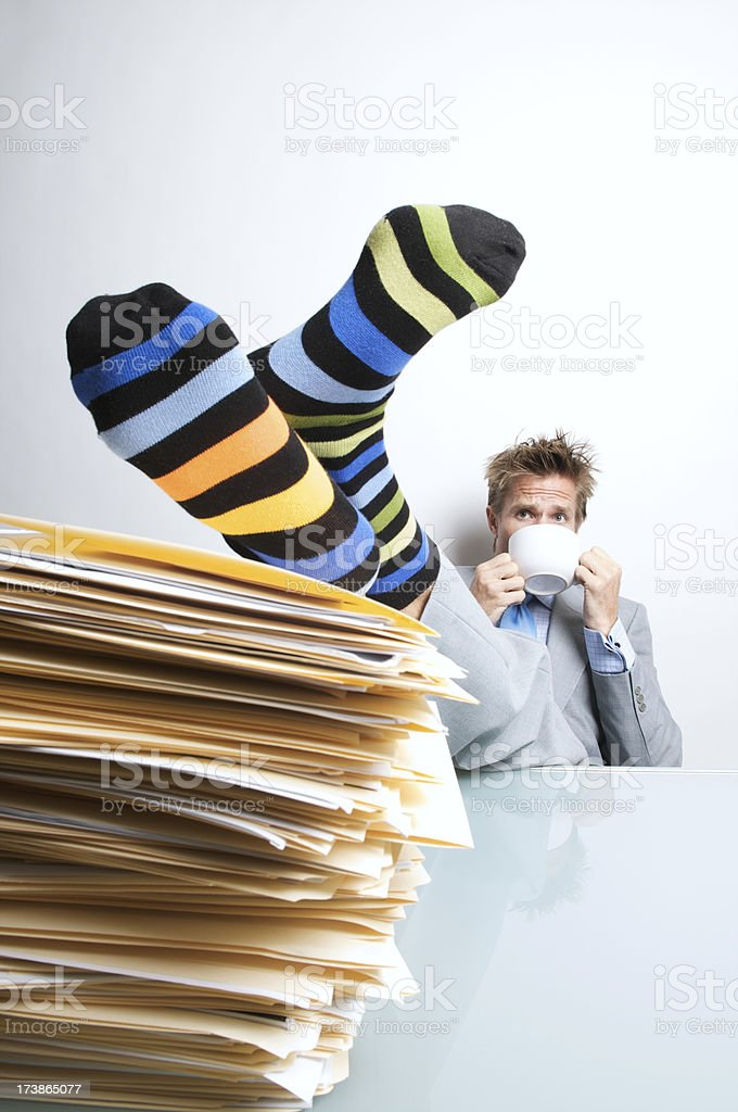 Office Worker Sips Coffee in his Socks royalty-free stock photo