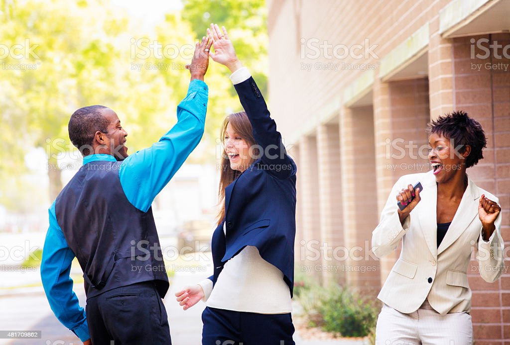 Office worker team celebrates good news hi five stock photo