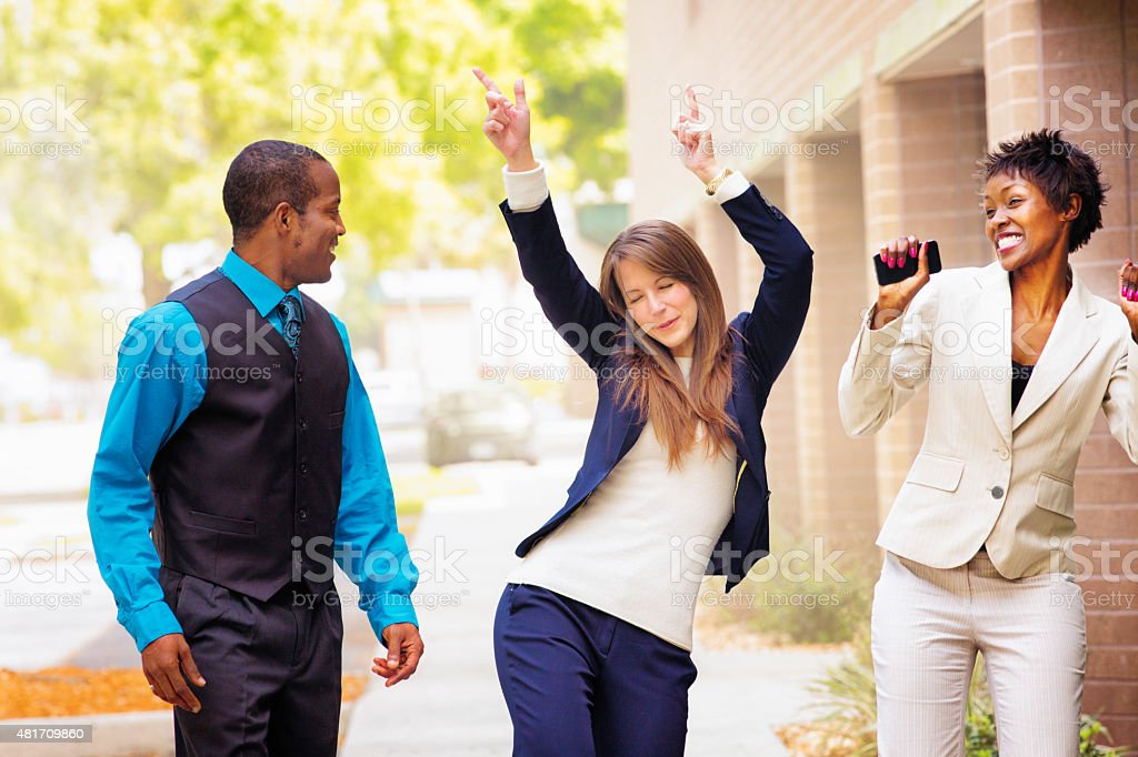 Office worker team does victory dance after receiving good news stock photo