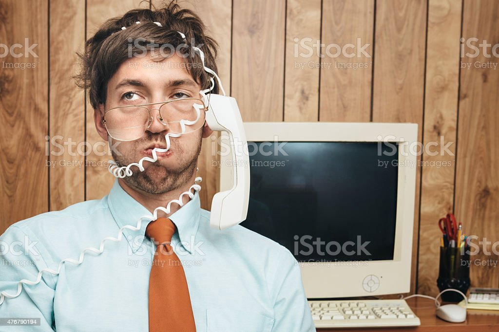 Office Worker Tied Up in Phone stock photo