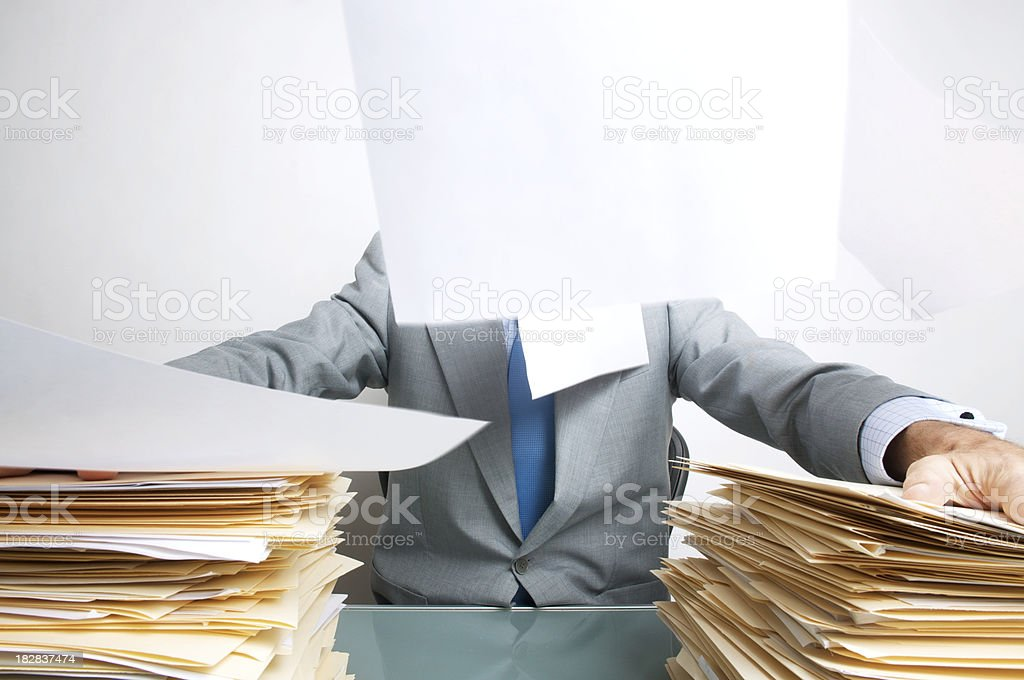 Office Worker Tries to Keep Paperwork Down royalty-free stock photo