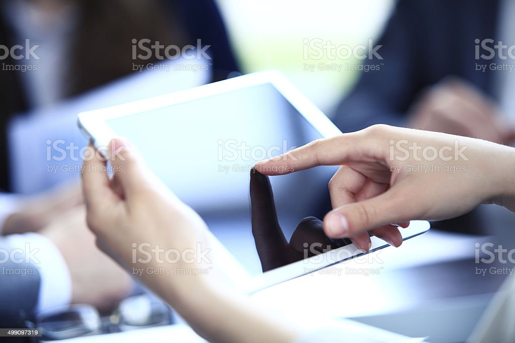 office worker using a touchpad to analyze statistical data stock photo