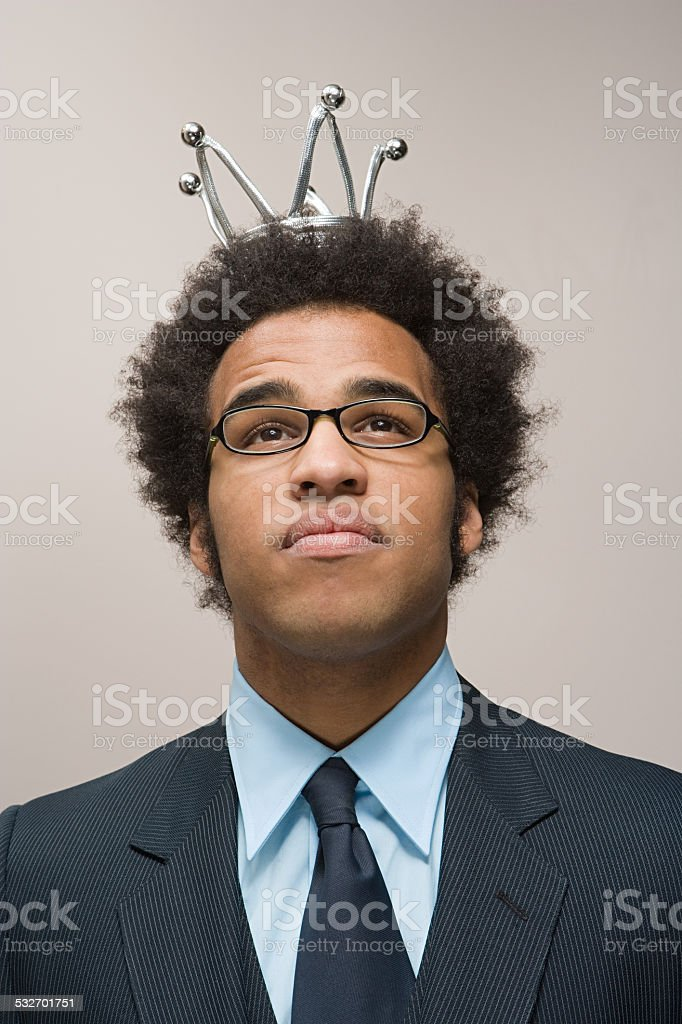 Office worker wearing a crown stock photo