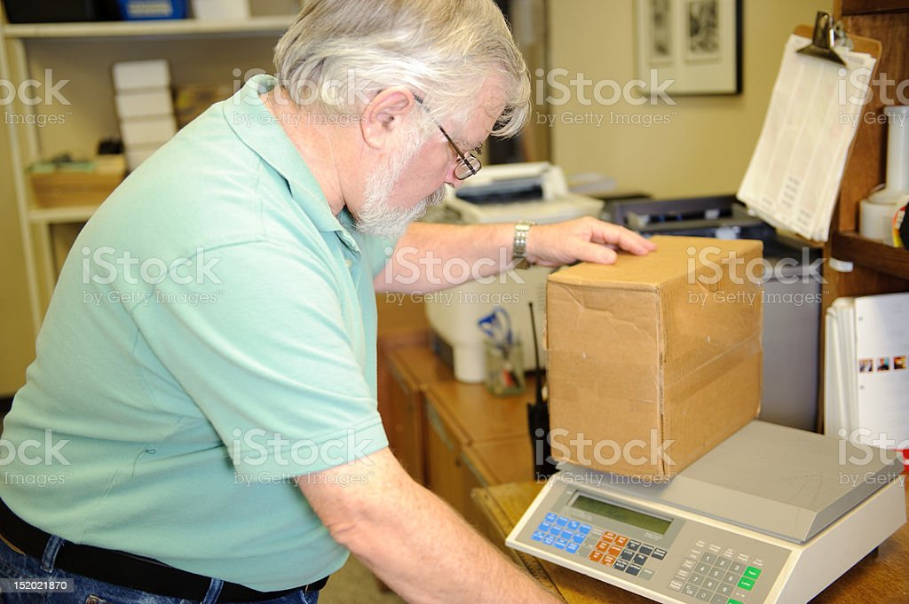 Office Worker Weights a Package royalty-free stock photo