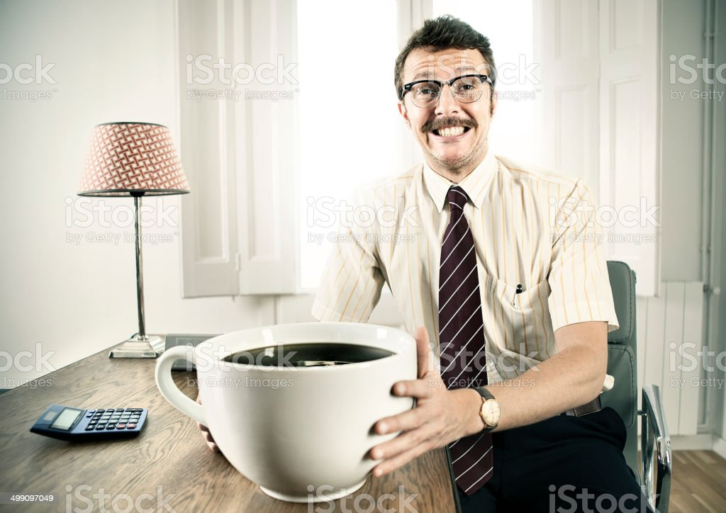 Office Worker With Giant Coffee stock photo