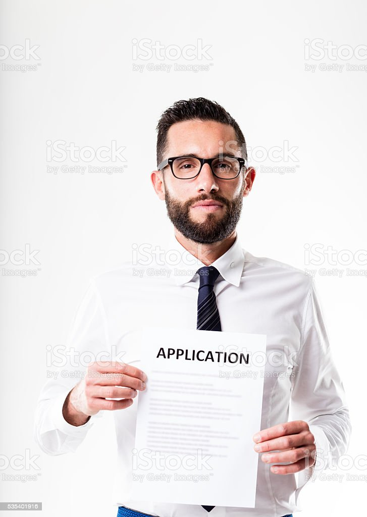 office worker with glasses showing an application form stock photo