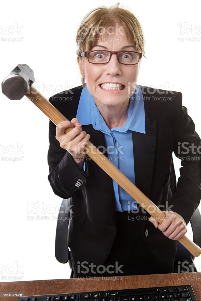 Office worker with hammer stock photo