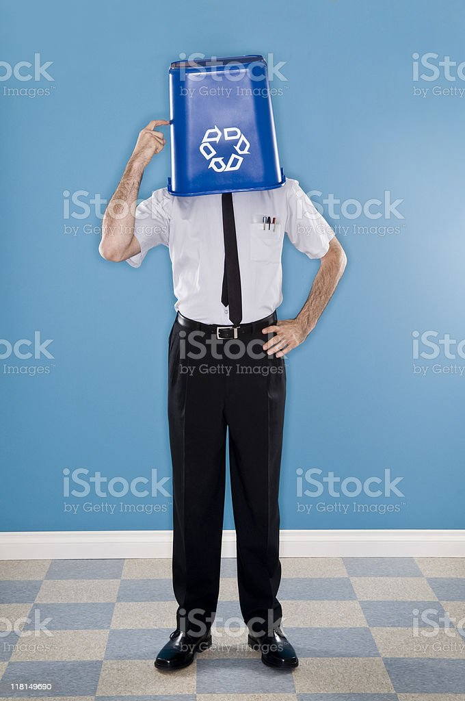 Office Worker With Head Inside Recyceling Container royalty-free stock photo