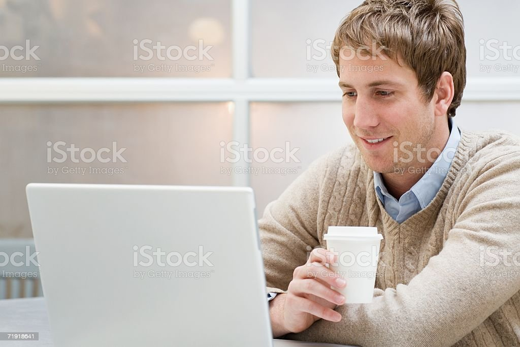Office worker with laptop and coffee royalty-free stock photo