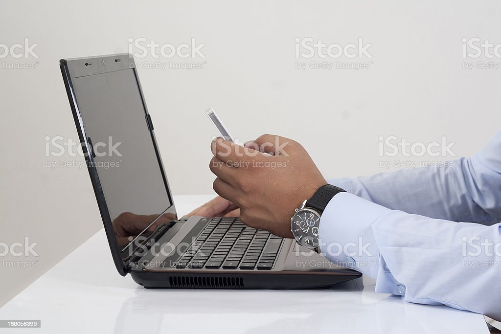 Office worker writing a text message royalty-free stock photo