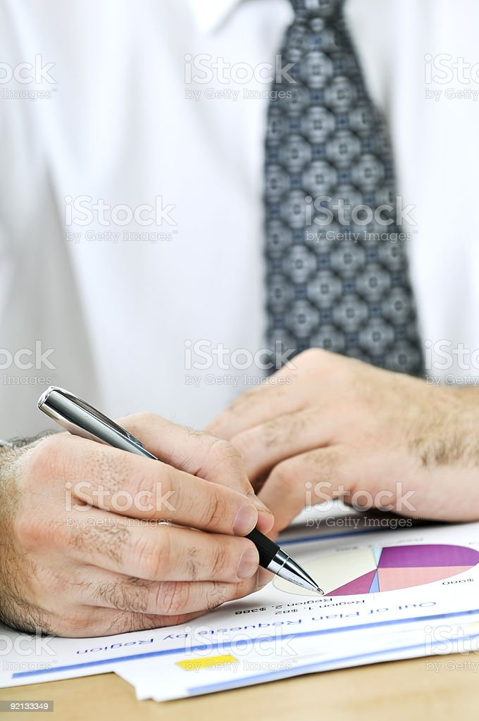 Office worker writing on reports royalty-free stock photo