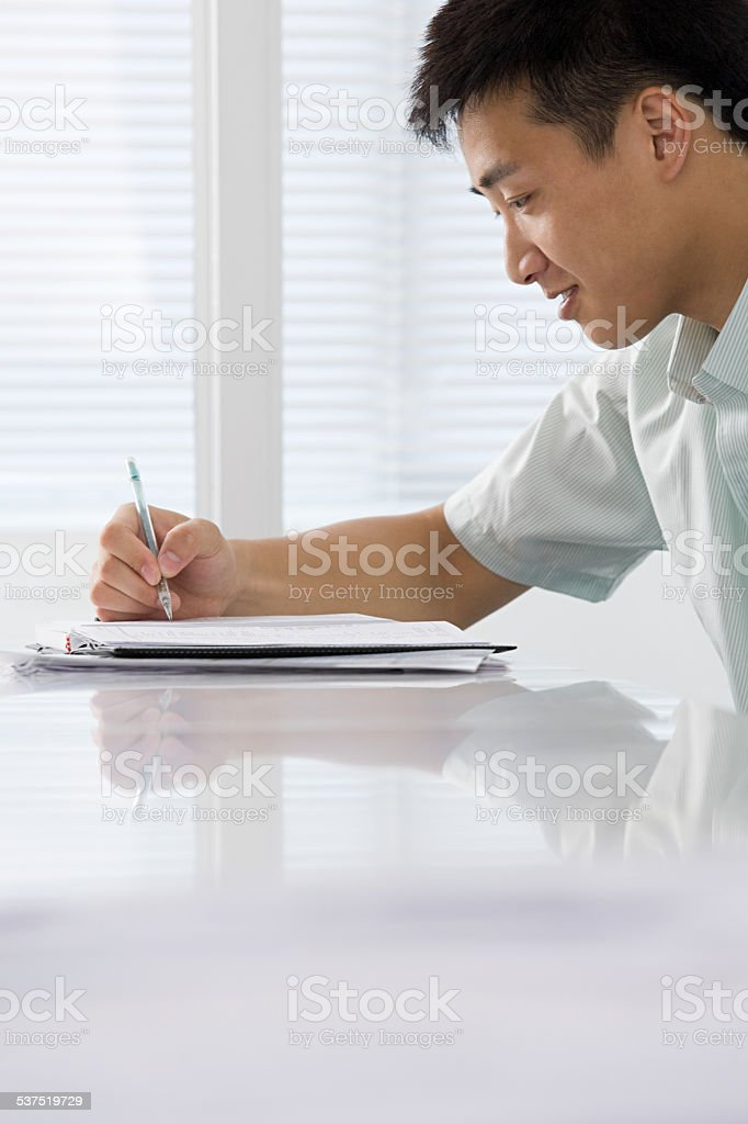 Office worker writing stock photo